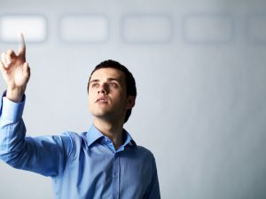 Image of young businessman pointing at virtual button, source: Citirecruitment